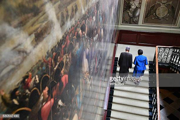 Patricia Scotland secretarygeneral of the Commonwealth speaks with Nigerian President Muhammadu Buhari on arrival at Marlborough house prior to the...