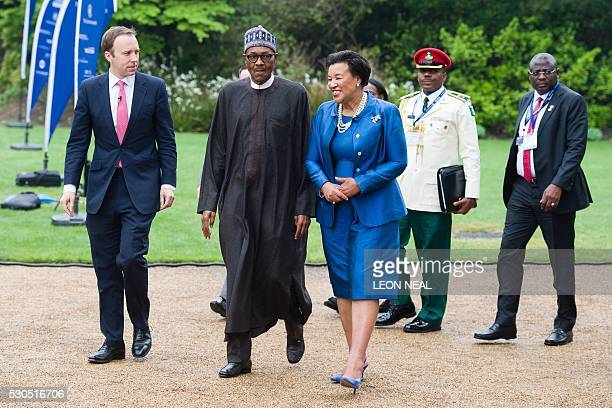 Patricia Scotland secretarygeneral of the Commonwealth walks with Nigerian President Muhammadu Buhari on their way to address delegates at a...