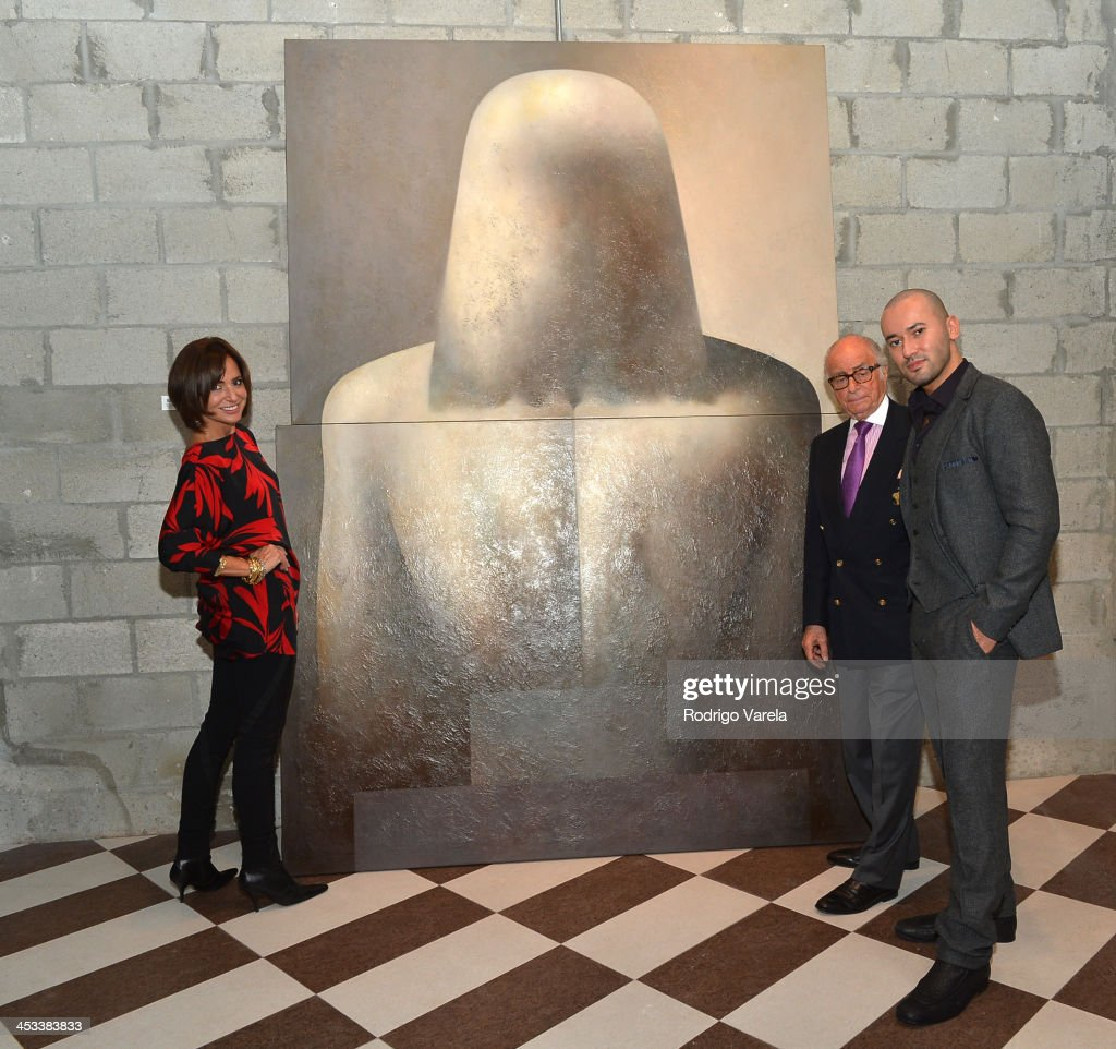 Patricia Shaheen, Bob Shaheen, and Dmitry Prut attend the Roman Kriheli Un:veiled Exhibit At Avant Gallery, Featuring The Unveiling Of 'The Most Beautiful Woman In The World' Painting at Epic Hotel on December 3, 2013 in Miami, Florida.