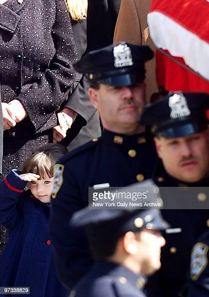 Patricia Smith salutes as casket is brought out of Our Lady of Lourdes Roman Catholic Church in Queens during funeral service for her mother, Police...