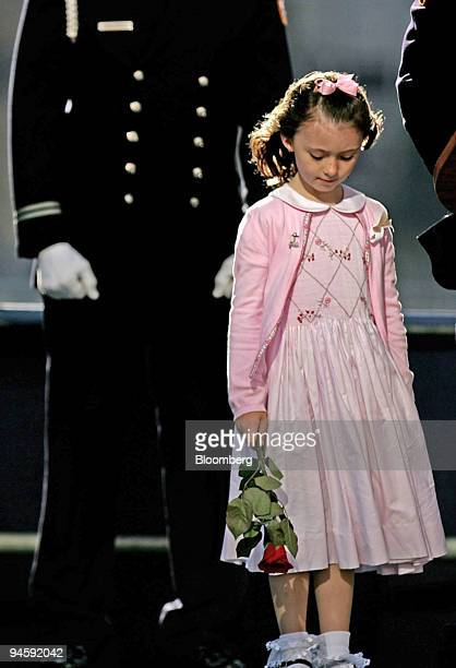 Patricia Smith, the daughter of New York Police Department Officer Moira Smith who was killed on 9-11, stands on stage during the reading of names of...