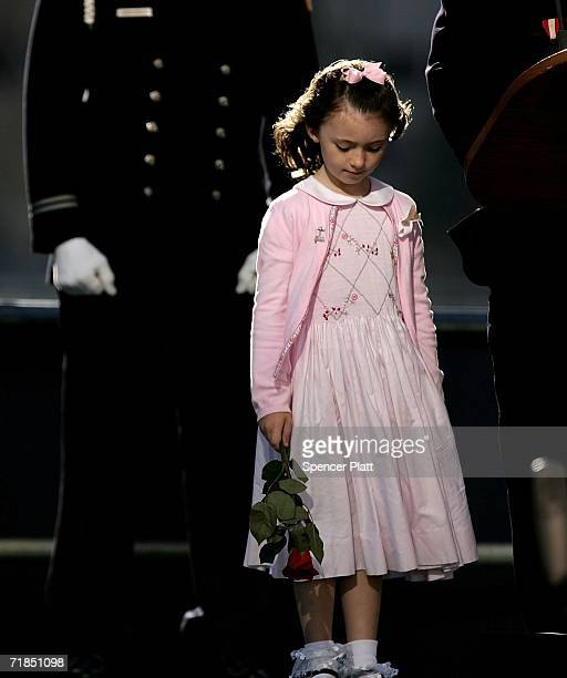 Patricia Smith, the daughter of police officer Moira Smith, killed on 9-11, stands on stage during the reading of names of victims of 9-11 during...