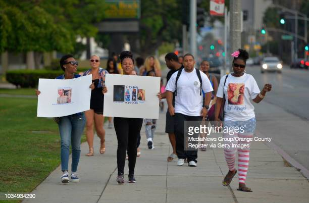 Patricia Todd center is joined by friends and family as they march from Poly High to the spot were her sister was murdered in Long Beach CA on Friday...