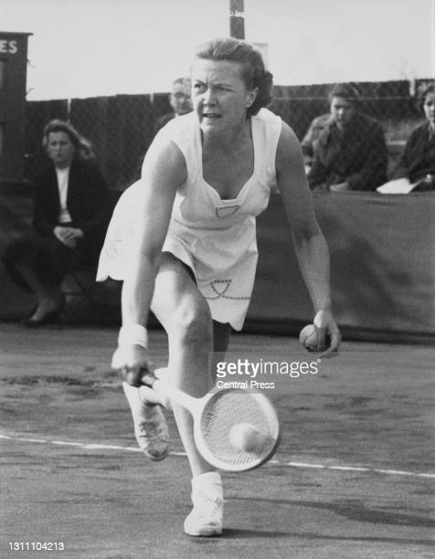 Patricia Ward of Great Britain makes a backhand return to Angela Mortimer during their Women's Singles Final match at the Surrey Hard Court...