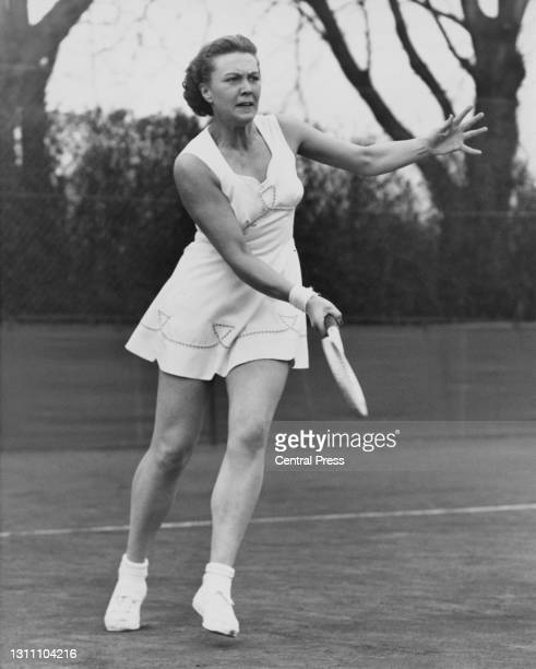 Patricia Ward of Great Britain makes a forehand return to Vera Thomas during their Women's Singles match at the Surrey Hard Court Championships on...
