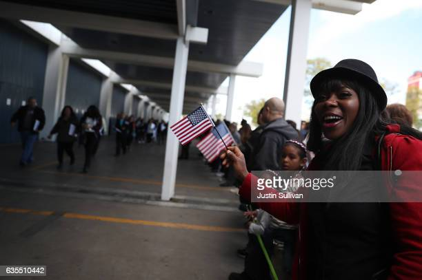 Patricia Williams greets newly sworn in US citizens outside of a naturalization ceremony held by US Citizenship and Immigration Services at the Los...