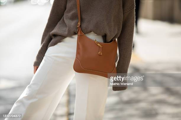 Patricia Wirschke, Fashion Blogger, art historian and ceo of high10art is seen wearing Moncler White Culottes, Hermès Bag Camel on April 15, 2021 in...