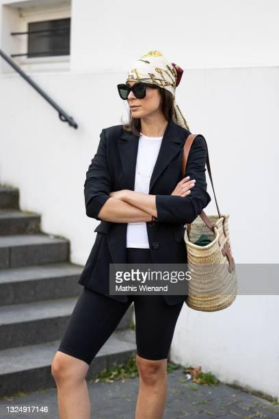 Patricia Wirschke, fashion blogger, art historian and CEO of high10art wearing Luisa cerano black blazer, lululemon cycling shorts, Celine basket...