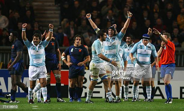 Patricio Albacete and the Argentina players celebrate their team's victory as the final whistle is blown at the end of the Bronze Final of the Rugby...