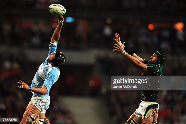 Patricio Albacete of Argentina jumps for the lineout ball with Victor Matfield of South Africa during the Rugby Word Cup Semi Final between South...