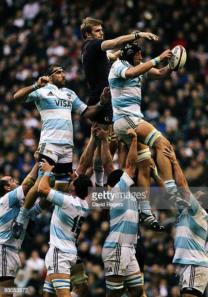Patricio Albacete of Argentina receives the ball under pressure from Tom Croft of England during the Investec Challenge match between England and...