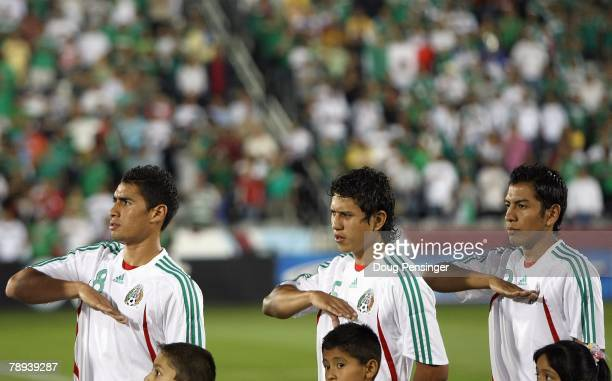 Patricio Araujo Julo Cesar Dominguez and Omar Esparza of Mexico observe the playing of their national anthem prior to their international friendly...