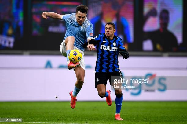 Patricio Gabarron Gil also known as Patric of SS Lazio is challenged by Alexis Sanchez of FC Internazionale during the Serie A football match between...