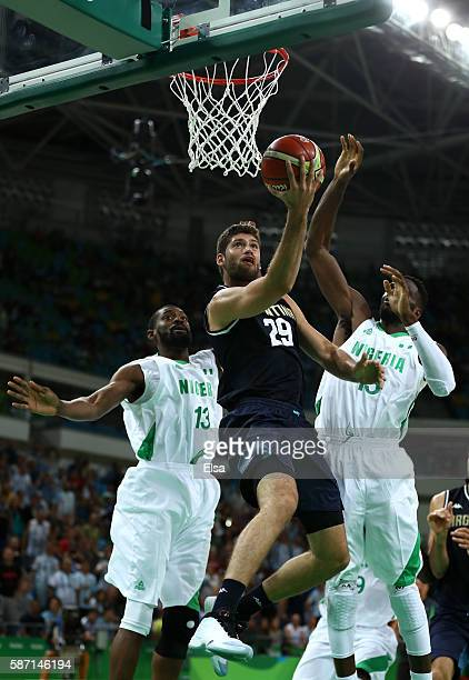 Patricio Garino of Argentina shoots against Olaseni Lawal and Ekene Ibekwe of Nigeria during a Men's preliminary round basketball game between...