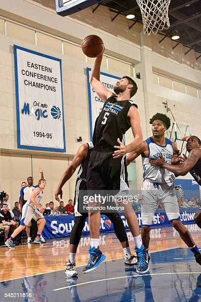 Patricio Garino of Magic White grabs the rebound against the New York Knicks on July 6 2016 during Summer League at the Amway Center in Orlando...