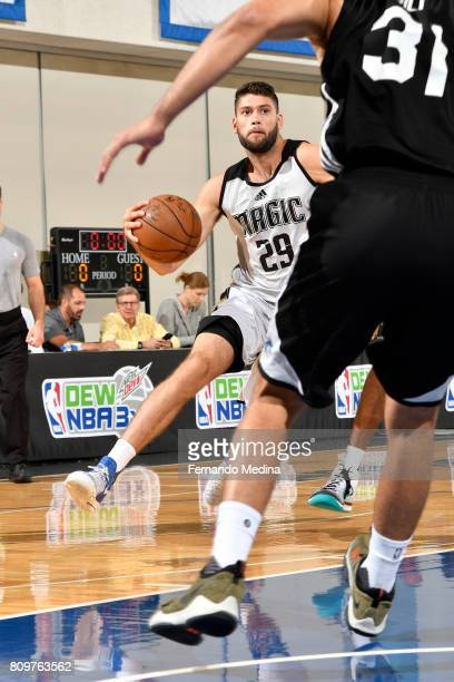 Patricio Garino of the Orlando Magic drives to the basket against the Charlotte Hornets during the Mountain Dew Orlando Pro Summer League on July 6...