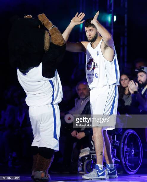 Patricio Garino of the White Team celebrates with the mascot during the 29th Liga Nacional AllStar Game at Roberto Pando Sports Center of San Lorenzo...
