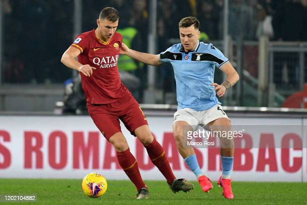 Patricio Gil Gabarron of SS Lazio compete for the ball with Edin Dzeko of AS Roma during the Serie A match between AS Roma and SS Lazio at Stadio...