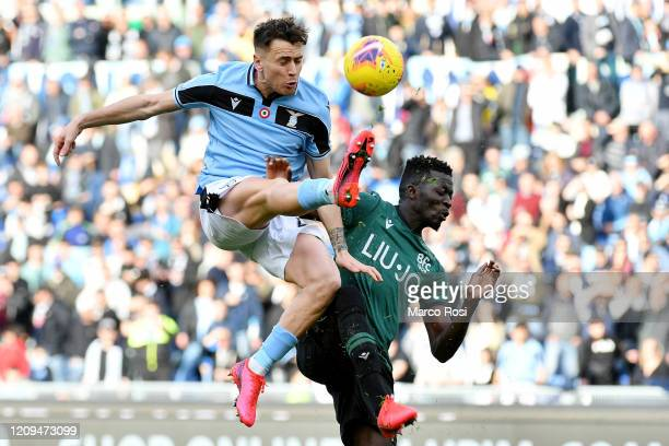 Patricio Gil Gbarron of SS Lazio compete for the ball with Musa Barrow of Bologna FC during the Serie A match between SS Lazio and Bologna FC at...