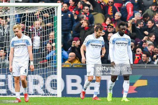 Patricio Patric Senad Lulic and Felipe Caicedo of Lazio react with disappointment after Antonio Sanabria of Genoa's goal during the Serie A match...