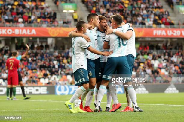 Patricio Perez of Argentina celebrates with team mates after scoring his team's second goal during the 2019 FIFA U20 World Cup group F match between...