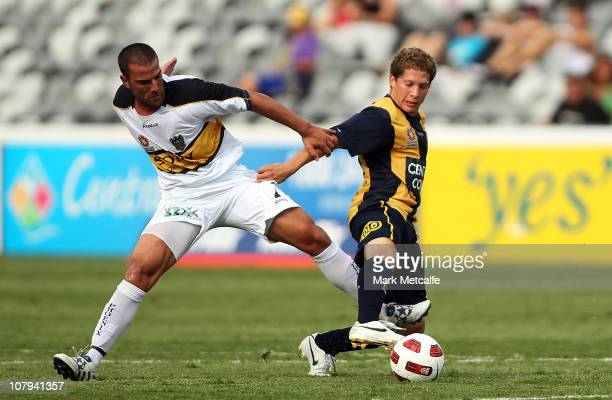 Patricio Perez of the Mariners is challenged by Emmanuel Muscat of the Phoenix during the round 22 A-League match between the Central Coast Mariners...