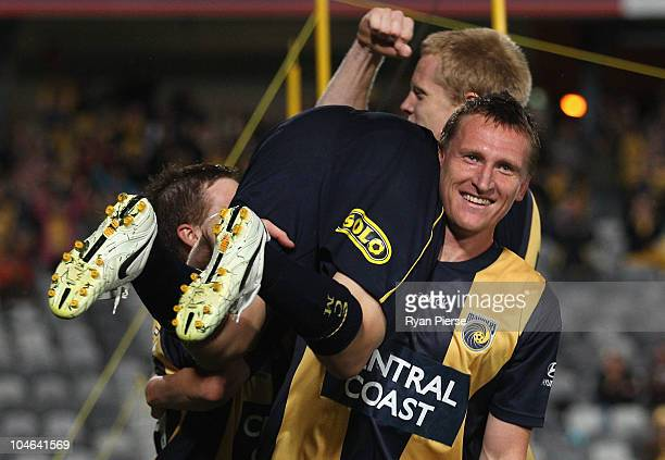 Patricio Perez of the Mariners is lifted up by Daniel McBreen after he scored his teams second goal during the round nine ALeague match between the...