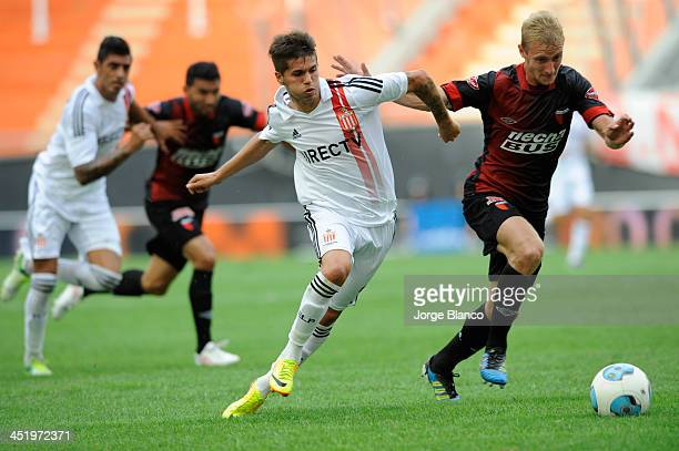 Patricio Rodriguez of Estudiantes fights for the ball Maximiliano Caire of Colon during a match as part of 17th round of Torneo Inicial 2013 at...