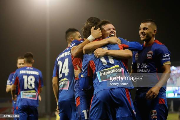 Patricio Rodriguez of the Jets celebrates his goal with team mates during the round 15 ALeague match between the Newcastle Jets and the Central Coast...