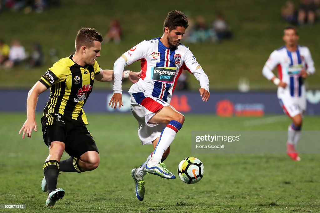 Patricio Rodriguez of the Newcastle Jets is marked by Scott Galloway of the Wellington Phoenix (L) during the round 23 A-League match between the Wellington Phoenix and the Newcastle Jets at QBE Stadium on March 17, 2018 in Auckland, New Zealand.