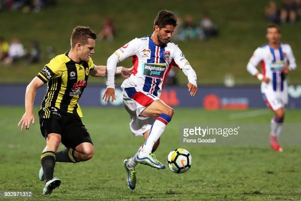 Patricio Rodriguez of the Newcastle Jets is marked by Scott Galloway of the Wellington Phoenix during the round 23 ALeague match between the...