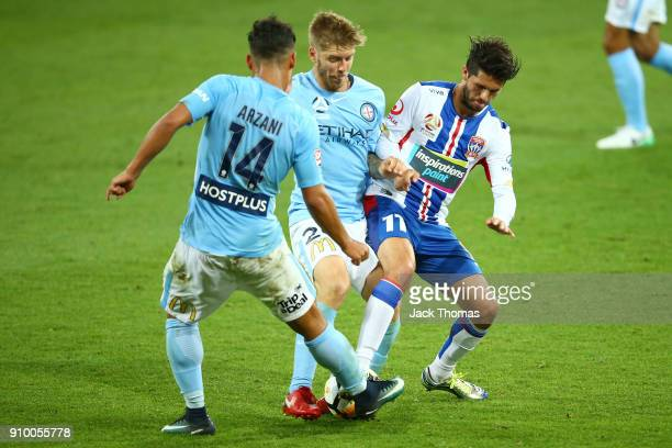 Patricio Rodriquez of the Jets Luke Brattan and Daniel Arzani of Melbourne City compete for the ball during the round 18 ALeague match between...