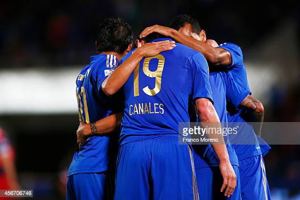 Patricio Rubio of Universidad de Chile celebrates with his teammates after scoring the second goal of his team during a match between U de Chile and...