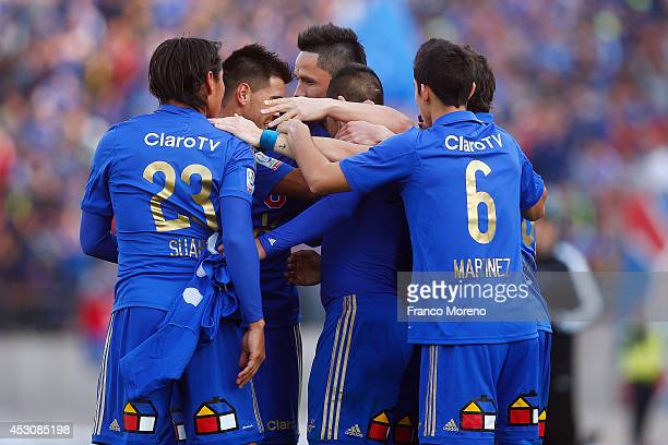 Patricio Rubio of Universidad de Chile celebrates with teammates the third goal of his team during a match between U de Chile and Wanderers as a part...