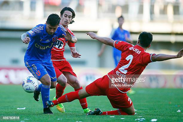 Patricio Rubio of Universidad de Chile fights for the ball with Andres Reyes of Ñublense during a match between Nublense and Universidad de Chile as...
