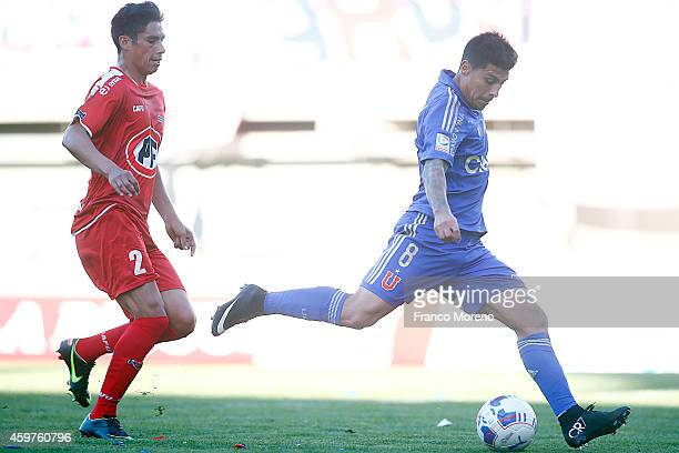 Patricio Rubio of Universidad de Chile shoots to score during a match between Nublense and Universidad de Chile as part of 16 round of Torneo...