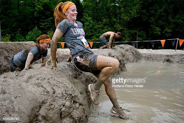 Patricipants in the Tough Mudder obstacle course a 103 mile trail run littered with hazards make their way through the mud mile during the race in...