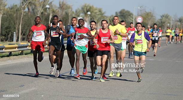 Patricipants run through the Iraqi capital during Baghdad's international marathon on January 29 2016 The marathon is organized by the Ministry of...