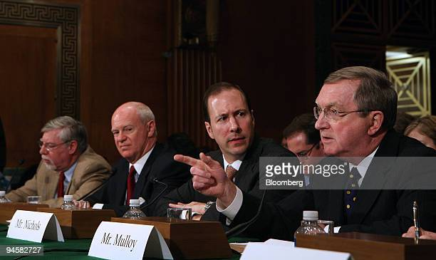 Patrick A Mulloy right Adjunct Professor George Mason School of Law makes a statement at a hearing of the US Senate Committee on Banking Housing and...