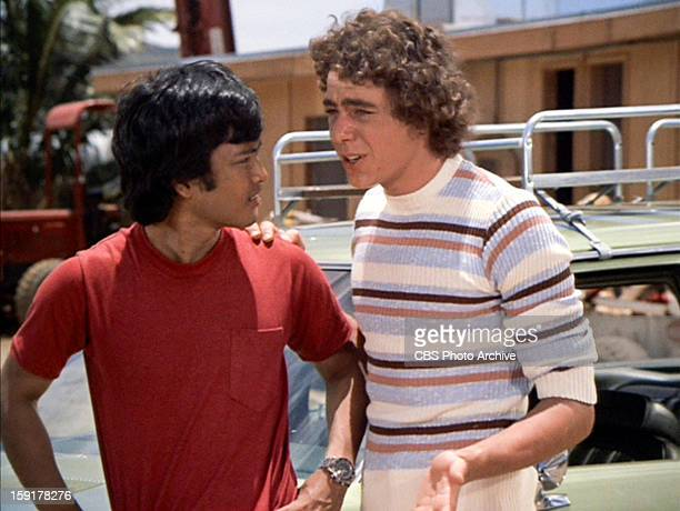 Patrick Adiarte as David and Barry Williams as Greg Brady in THE BRADY BUNCH episode Hawaii Bound Original air date September 22 1972 Image is a...