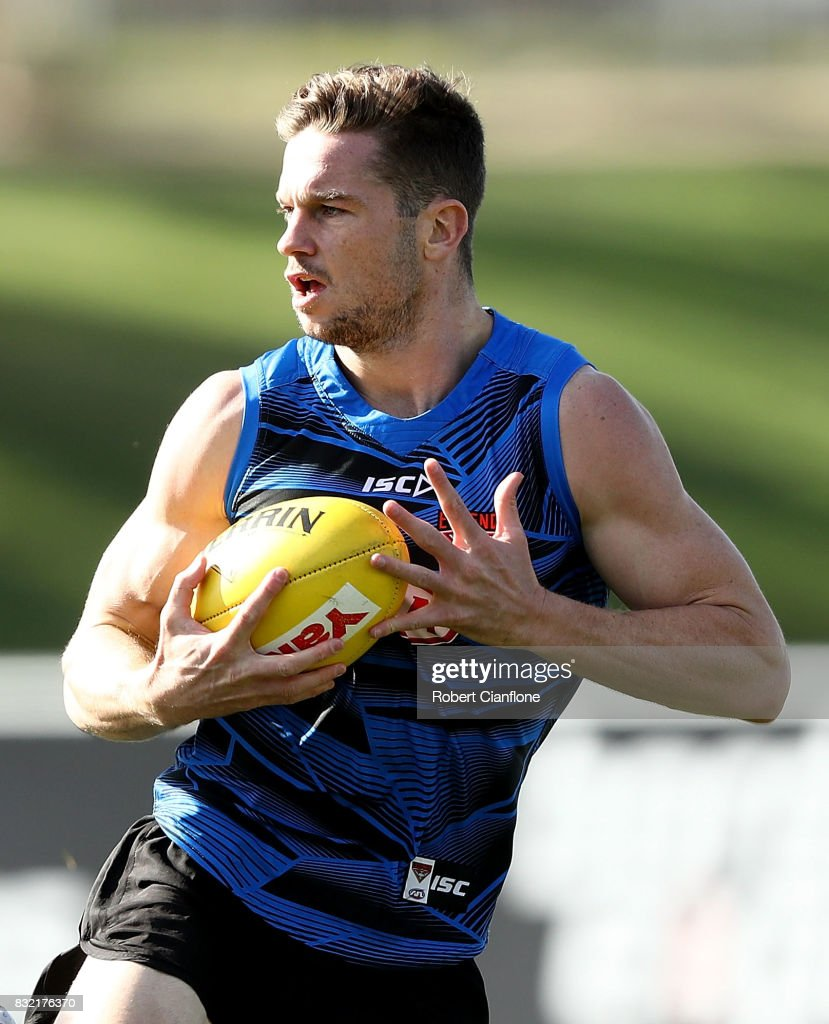Patrick Ambrose of the Bombers runs with the ball during an Essendon Bombers AFL training session at the Essendon Football Club on August 16, 2017 in Melbourne, Australia.