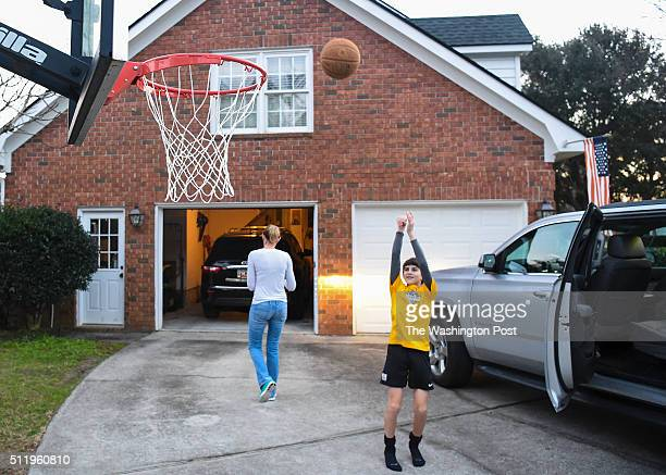Patrick Antonelli shoots hoops while he waits for his mom Debbie Antonelli to drive him to soccer practice flowing his basketball game on January 25...