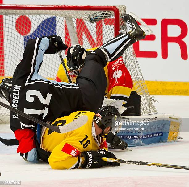 Patrick Asselin of Soenderjyske and Thomas Supis of Krefeld tripping over each other during the Champions Hockey League group stage game between...