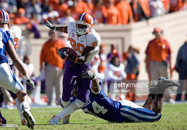 Patrick Bailey of the Duke Blue Devils works to bring down Aaron Kelly of the Clemson Tigers at Wallace Wade Stadium on November 3 2007 in Durham...