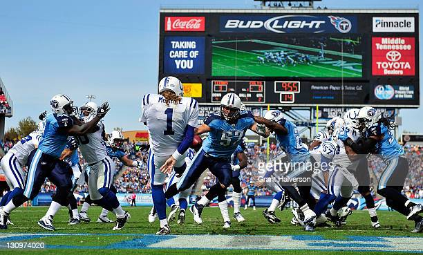Patrick Bailey of the Tennessee Titans blocks a punt by Pat McAfee of the Indianapolis Colts during play at LP Field on October 30 2011 in Nashville...