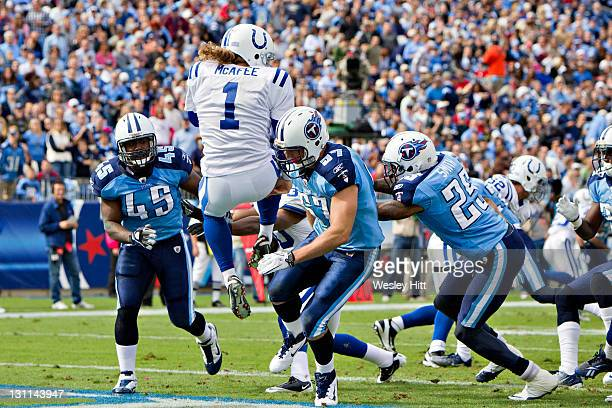 Patrick Bailey of the Tennessee Titans blocks the punt of Pat McAfee of the Indianapolis Colts at the LP Field on October 30 2011 in Nashville...