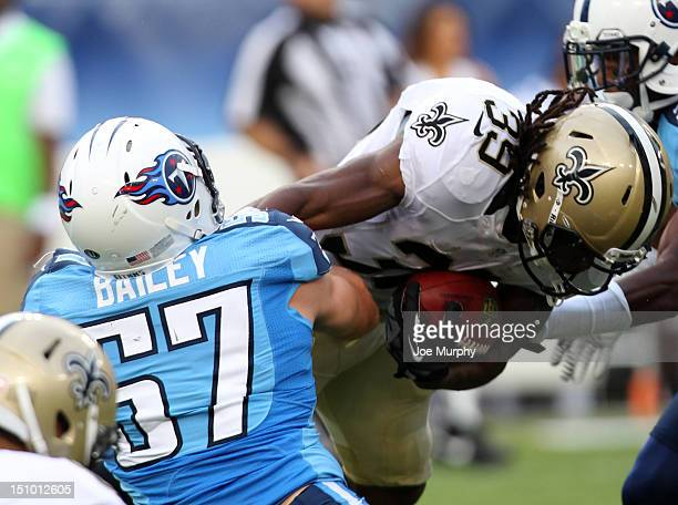 Patrick Bailey of the Tennessee Titans tackles Travaris Cadet of the New Orleans Saints at LP Field on August 30 2012 in Nashville Tennessee