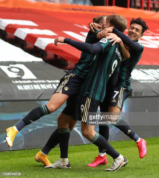 Patrick Bamford of Leeds celebrates scoring the only goal of the match with Luke Ayling and Ian Poveda of Leeds during the Premier League match...