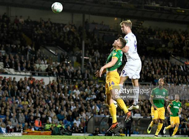 Patrick Bamford of Leeds United and Jordan Storey of Preston North End compete for the ball during the Carabao Cup Second Round match between Leeds...