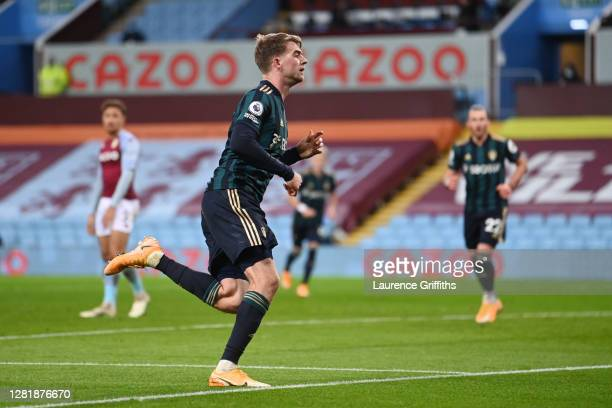Patrick Bamford of Leeds United celebrates after scoring his team's third goal during the Premier League match between Aston Villa and Leeds United...